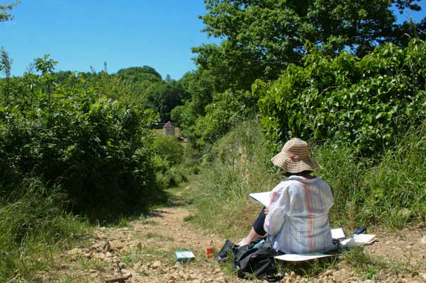 artists painting in the countryside on a path