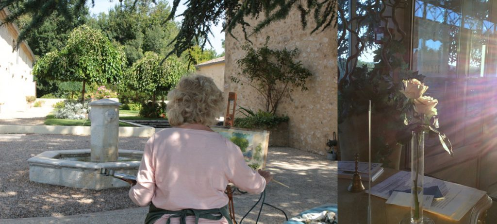 painter over the shoulder courtyard french chateau with roses